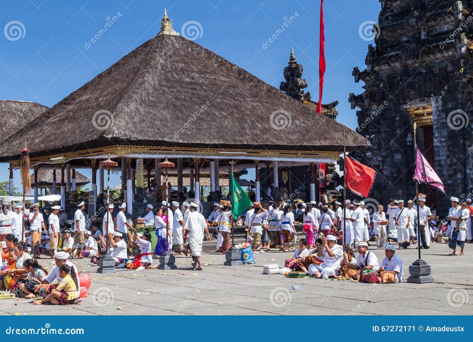 Village of Besakih, Bali/Indonesia - circa October 2015: People praying in Pura Besakih Balinese temple