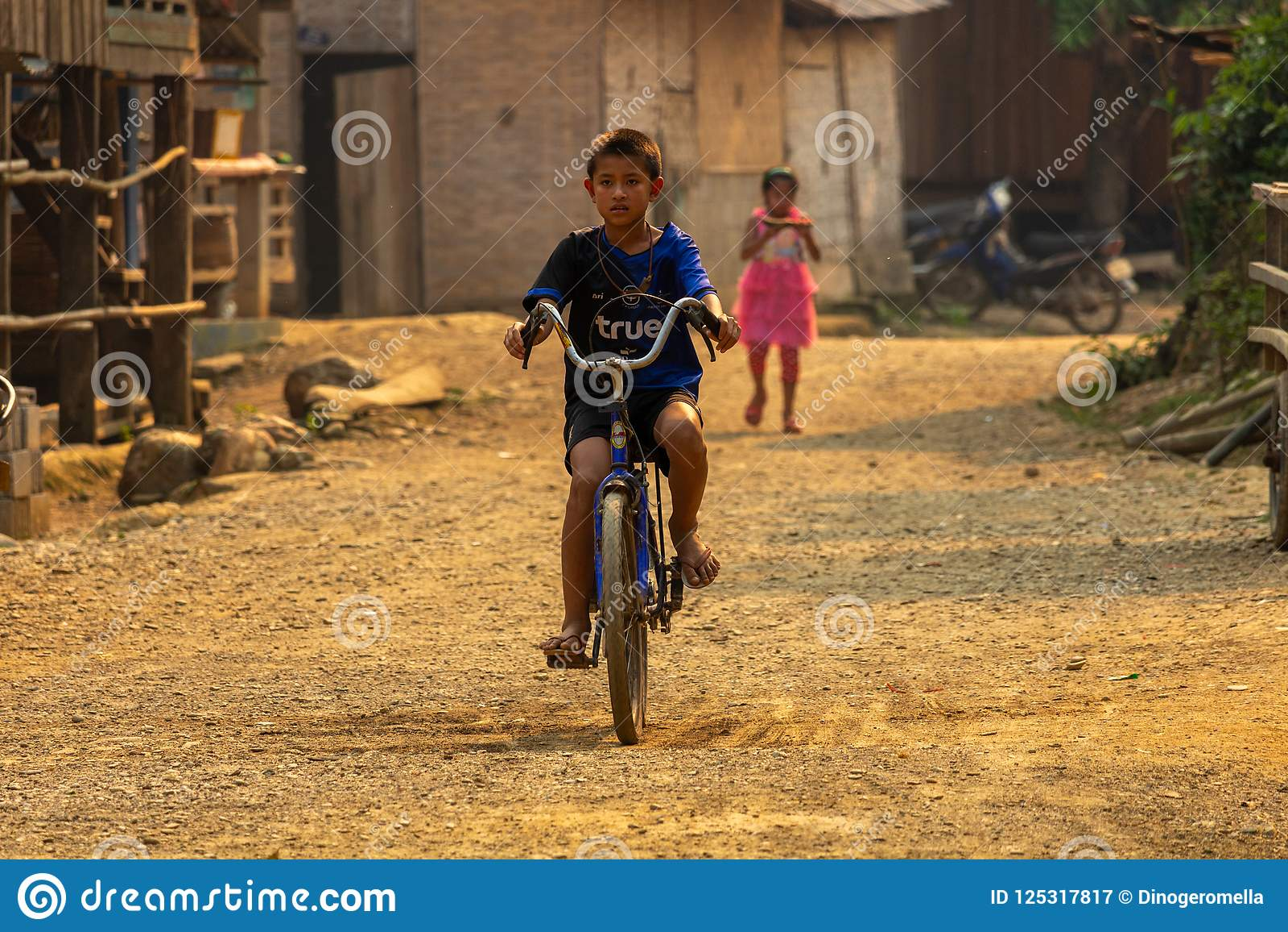 Village child biking Laos