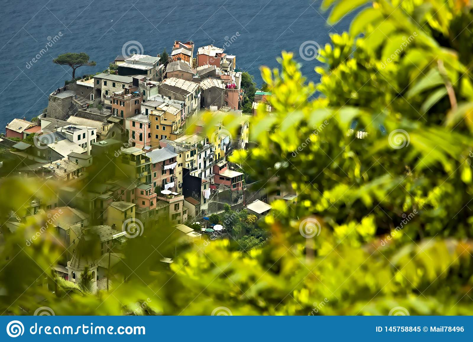 The village of Corniglia, Cinque Terre seen from a path on the hill overlooking the sea
