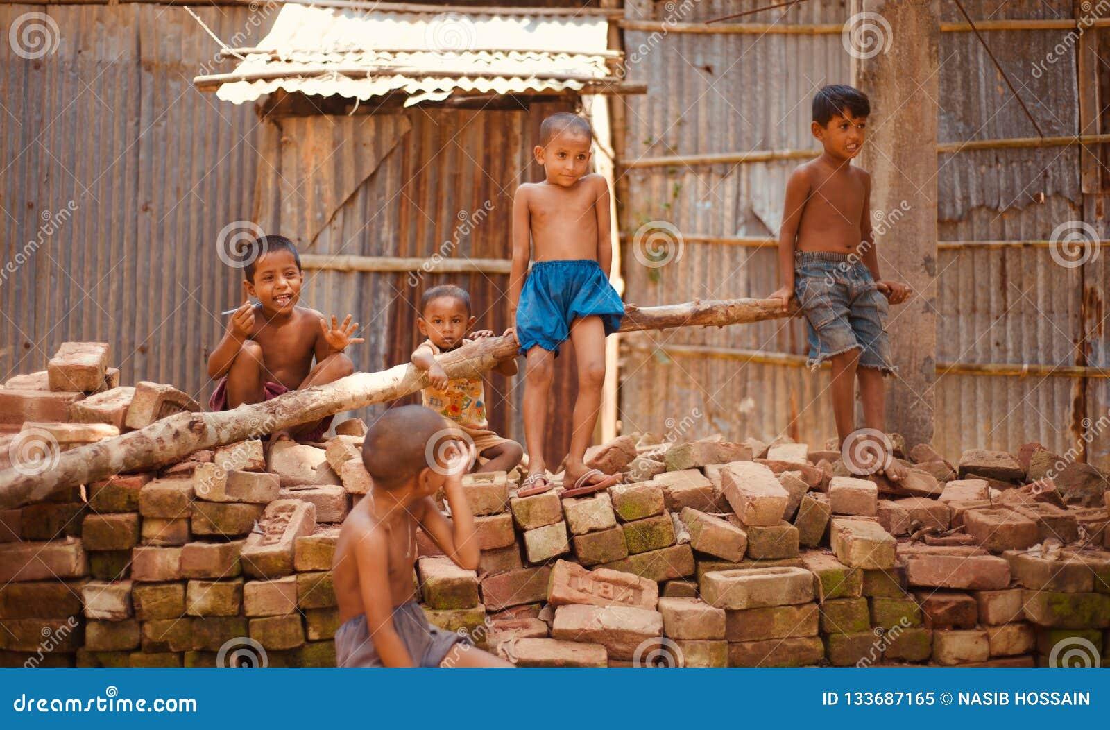 Village kids sitting around a place