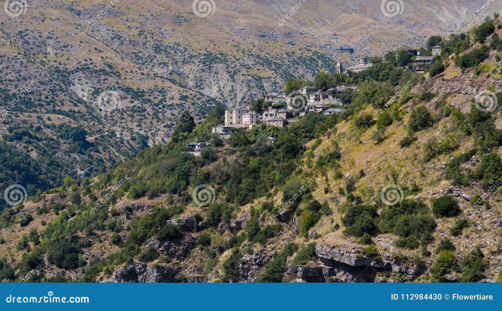 Village in the mountain in National Park of Tzoumerka, Greece Epirus region. Mountain in the clouds