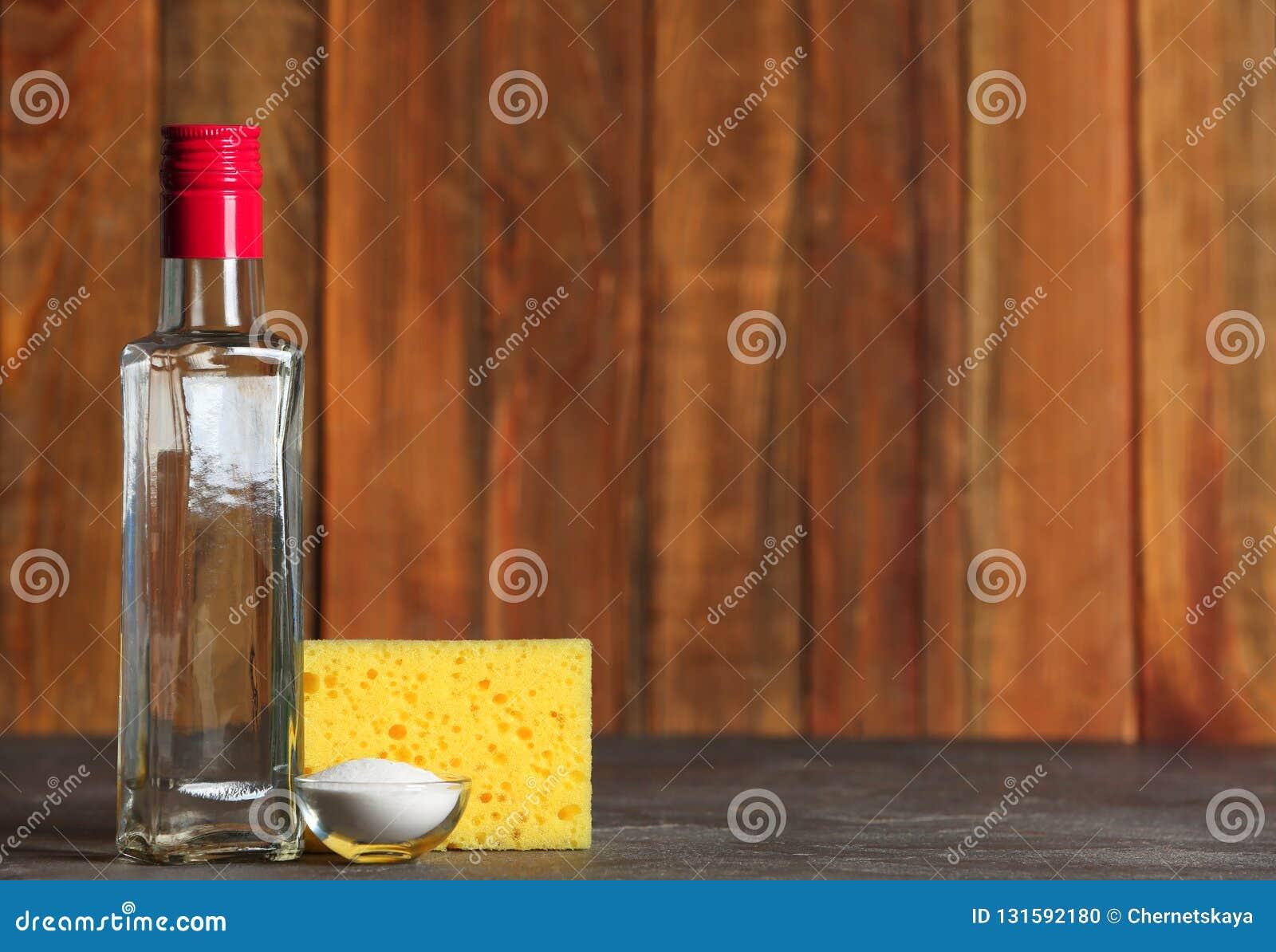 Vinegar, baking soda and sponge for cleaning