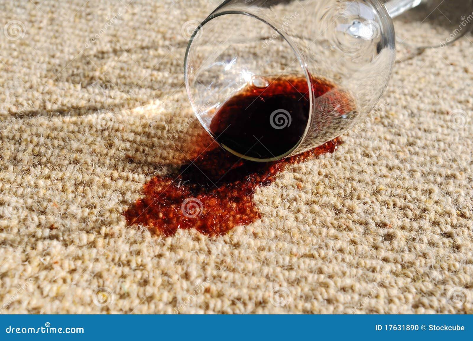 Vino derramado en la alfombra