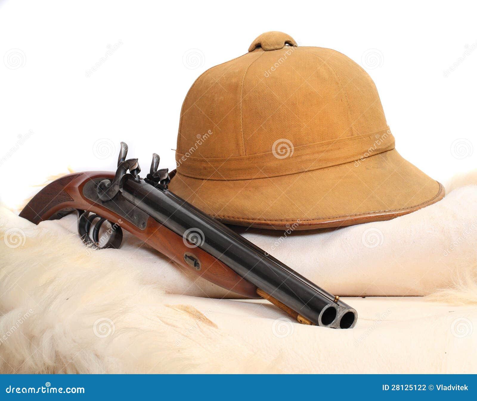 ... for safari hunters. Tropical cork helmet and big pistol on a animal