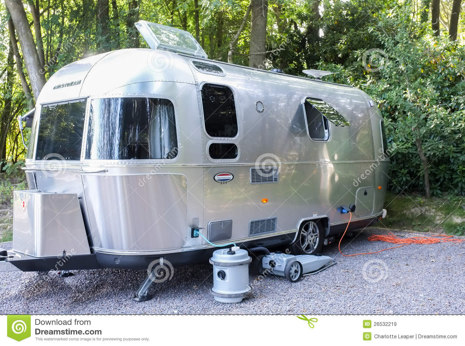 vintage airstream trailer on campsite editorial stock image image 26532219. Black Bedroom Furniture Sets. Home Design Ideas