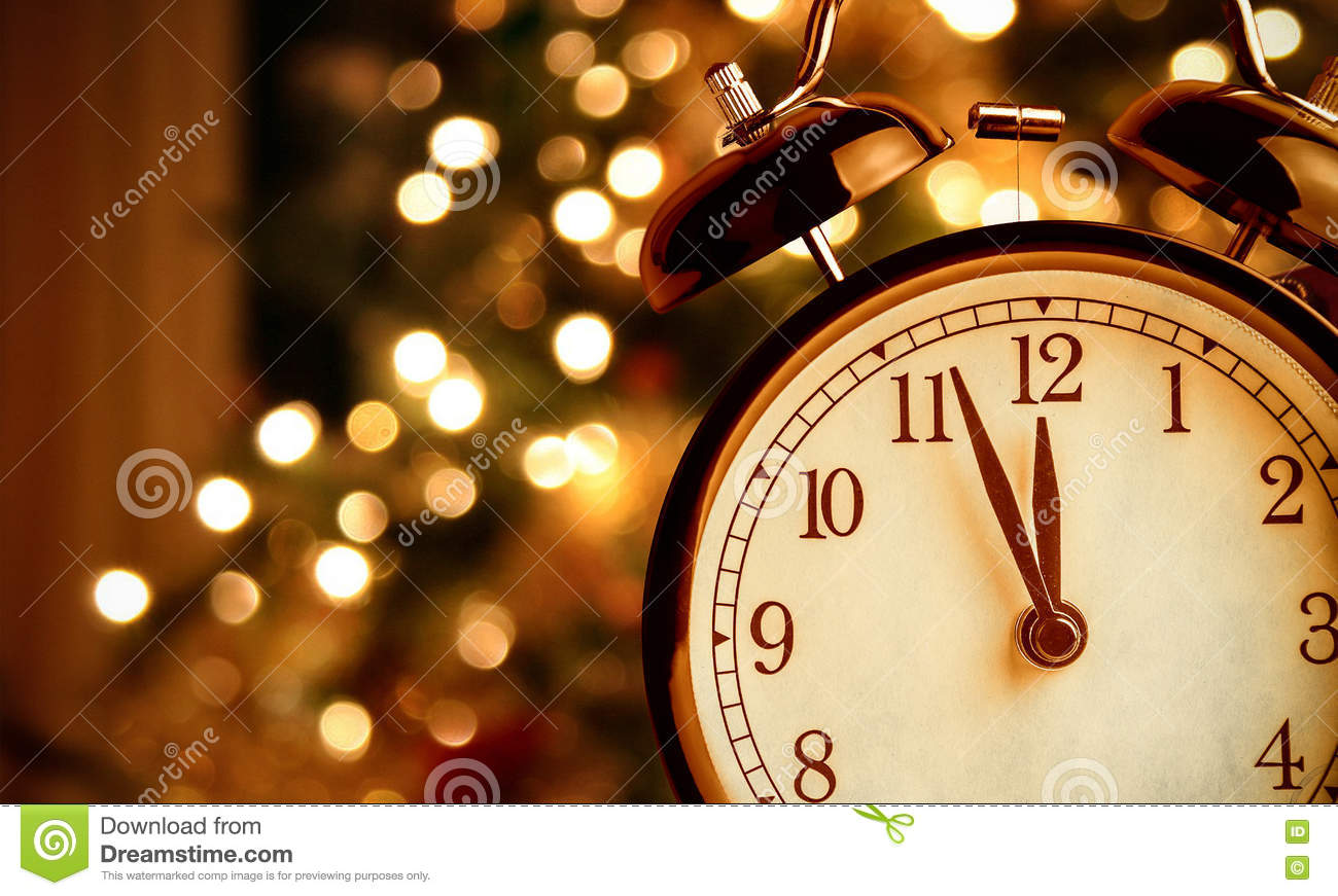 Vintage alarm clock is showing midnight. It is twelve o`clock, christmas and bokeh, holiday happy new year festive concept