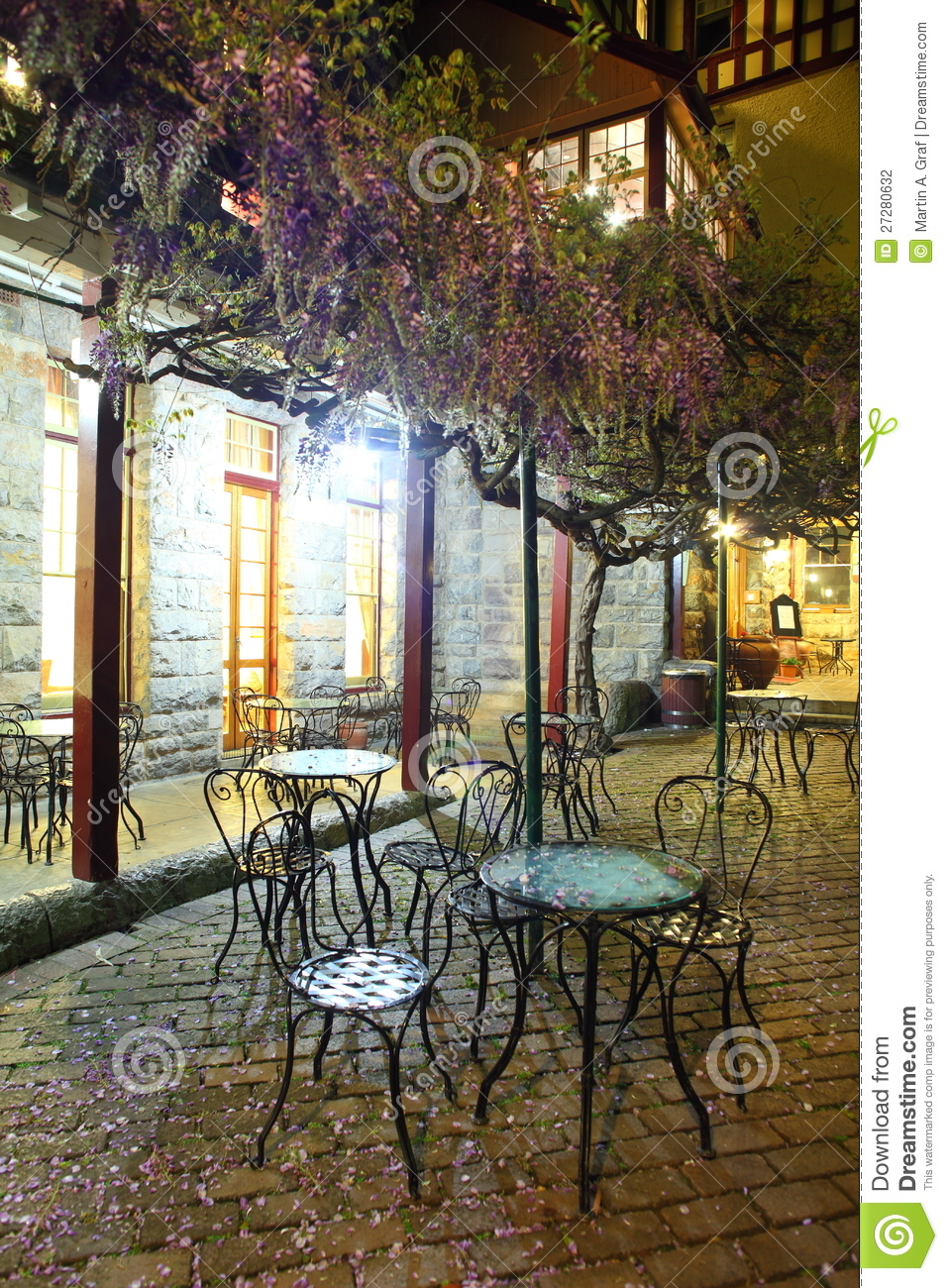Petals Covering Bistro Chairs Night Scenery Stock