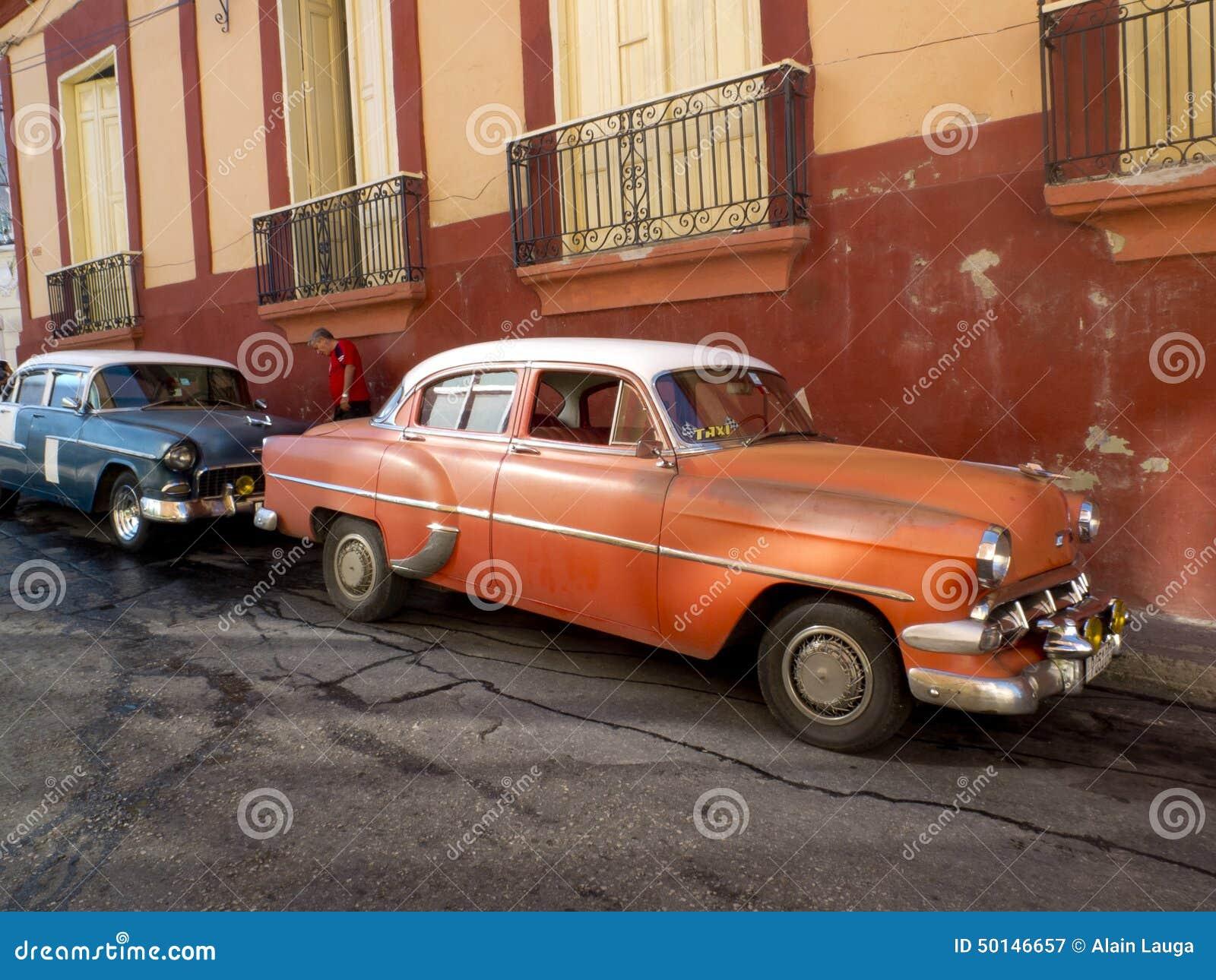 Vintage american cars parked in Santiago de Cuba.