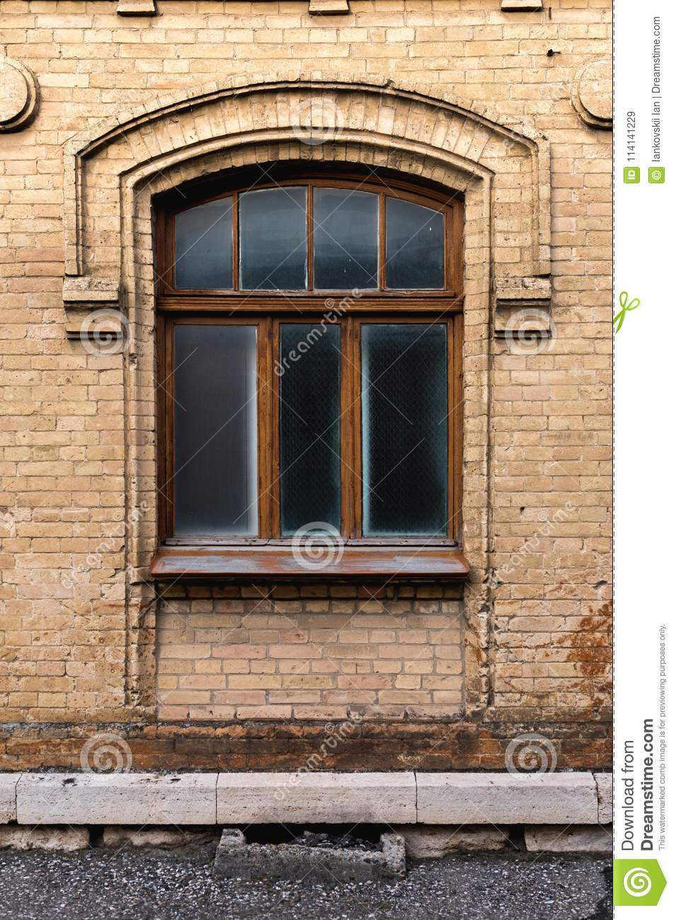 Vintage Arched Window In The Wall Of Yellow Brick Black