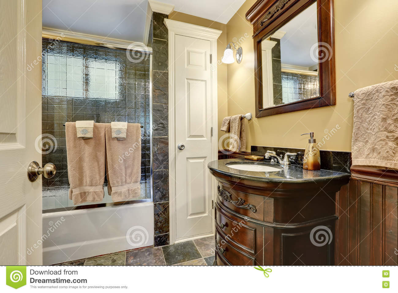 vintage bathroom interior with natural stone tile trim stock photo