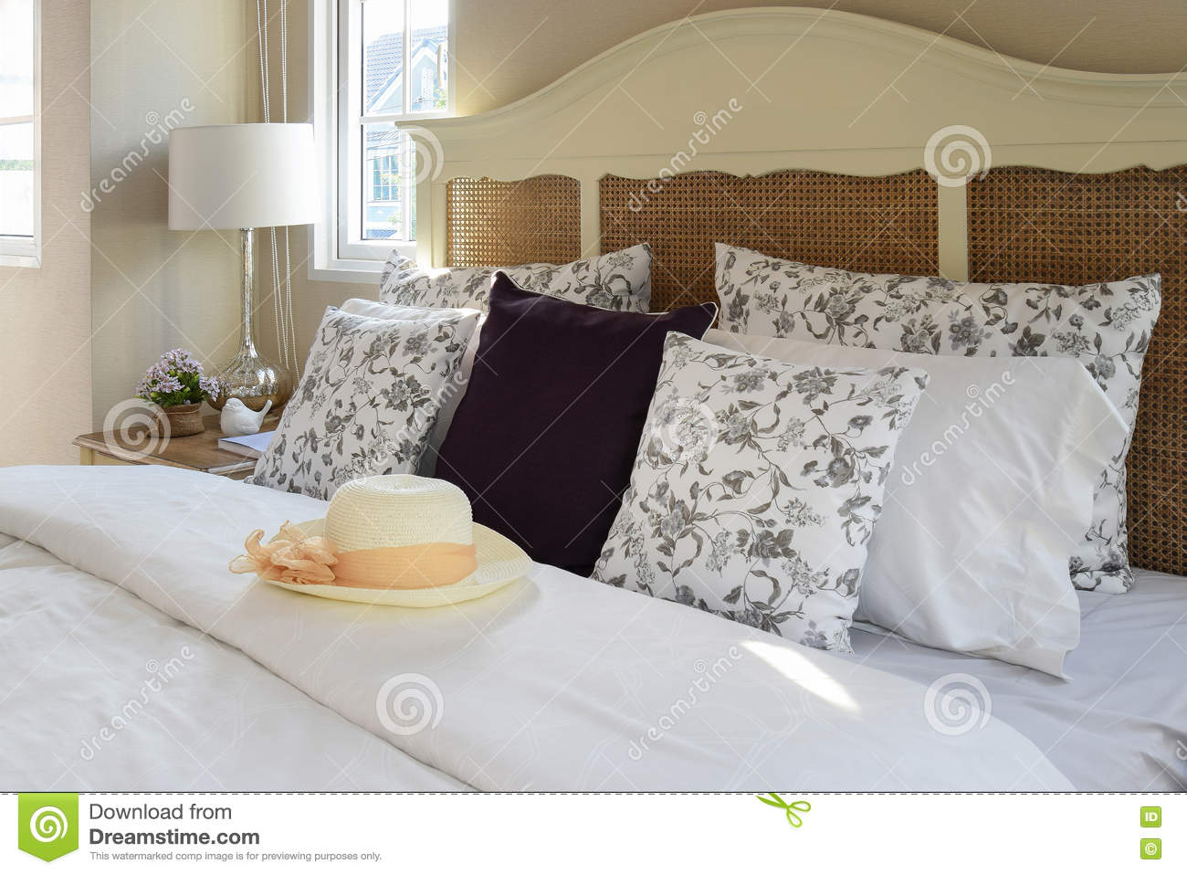 Vintage Bedroom Interior With Flower Pillows And Decorative Table ...