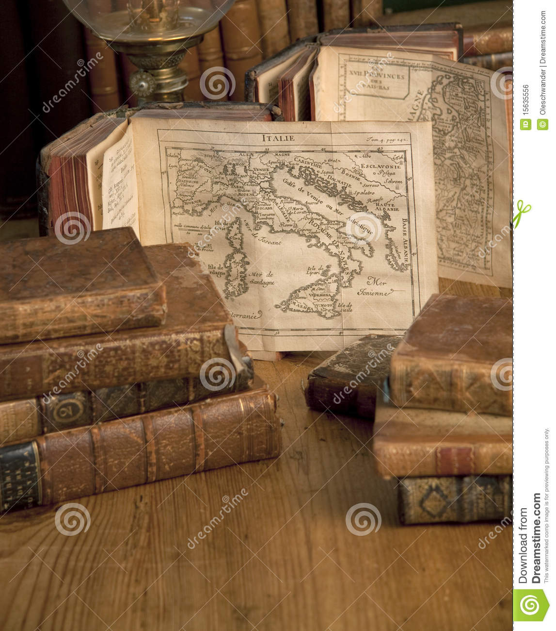 Vintage books old maps on a wooden table