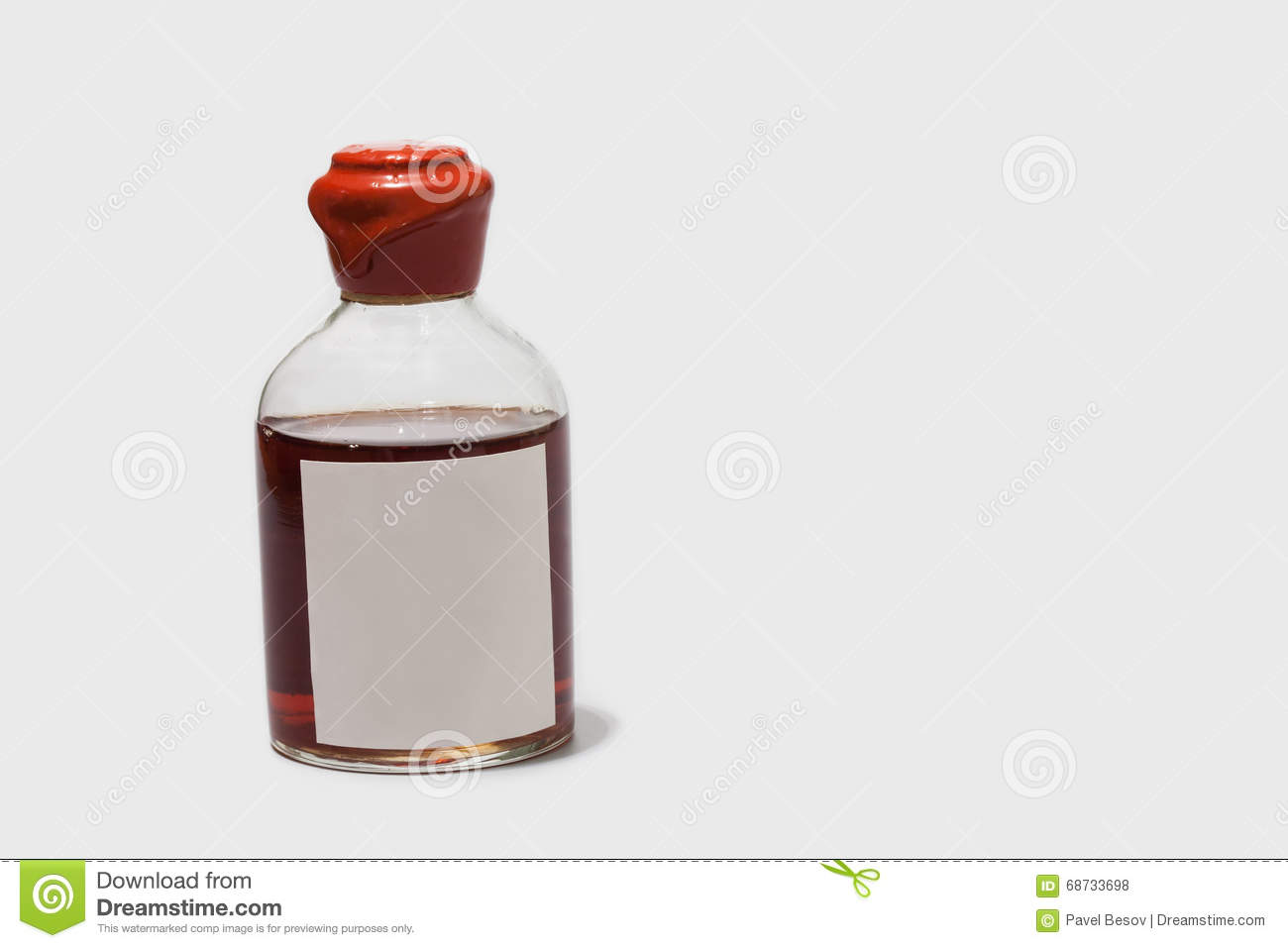 vintage bottle with red wax cork, brown booze and blank label. retro