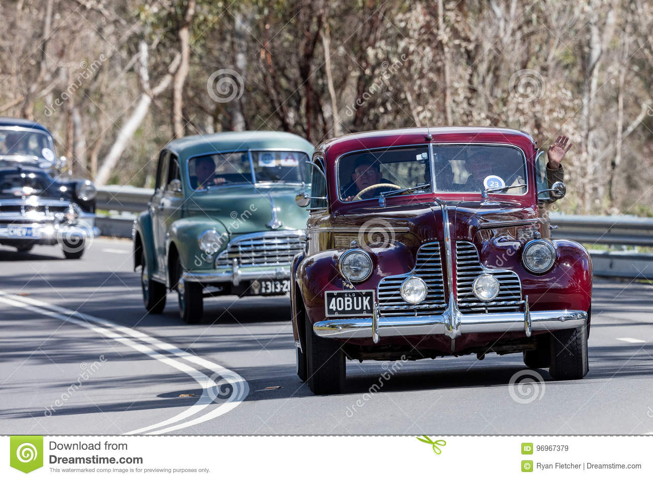 vintage 1940 buick special coupe driving on country road editorial