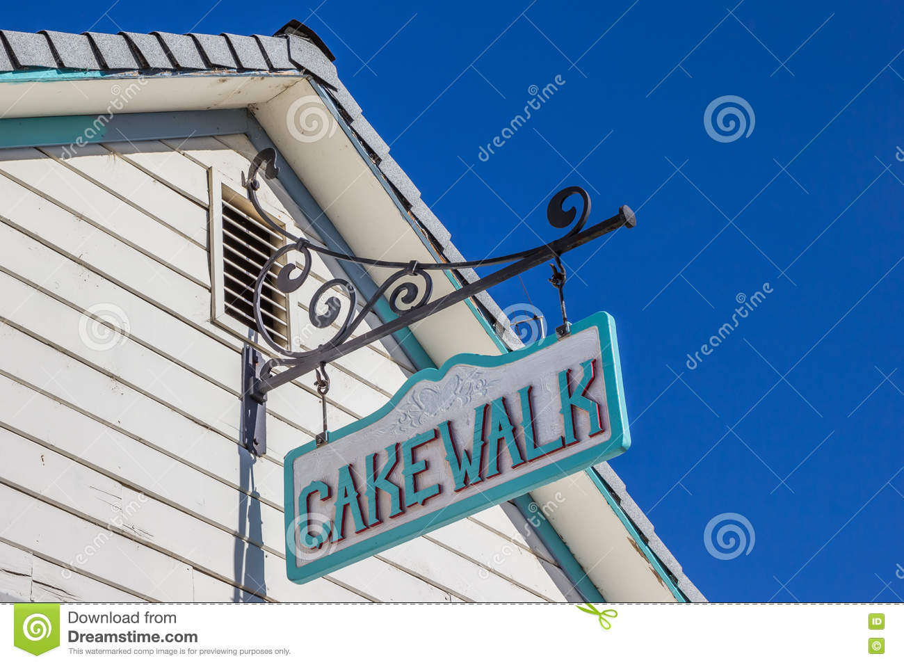 Vintage Cakewalk Sign On A Building In Main Street Coulterville