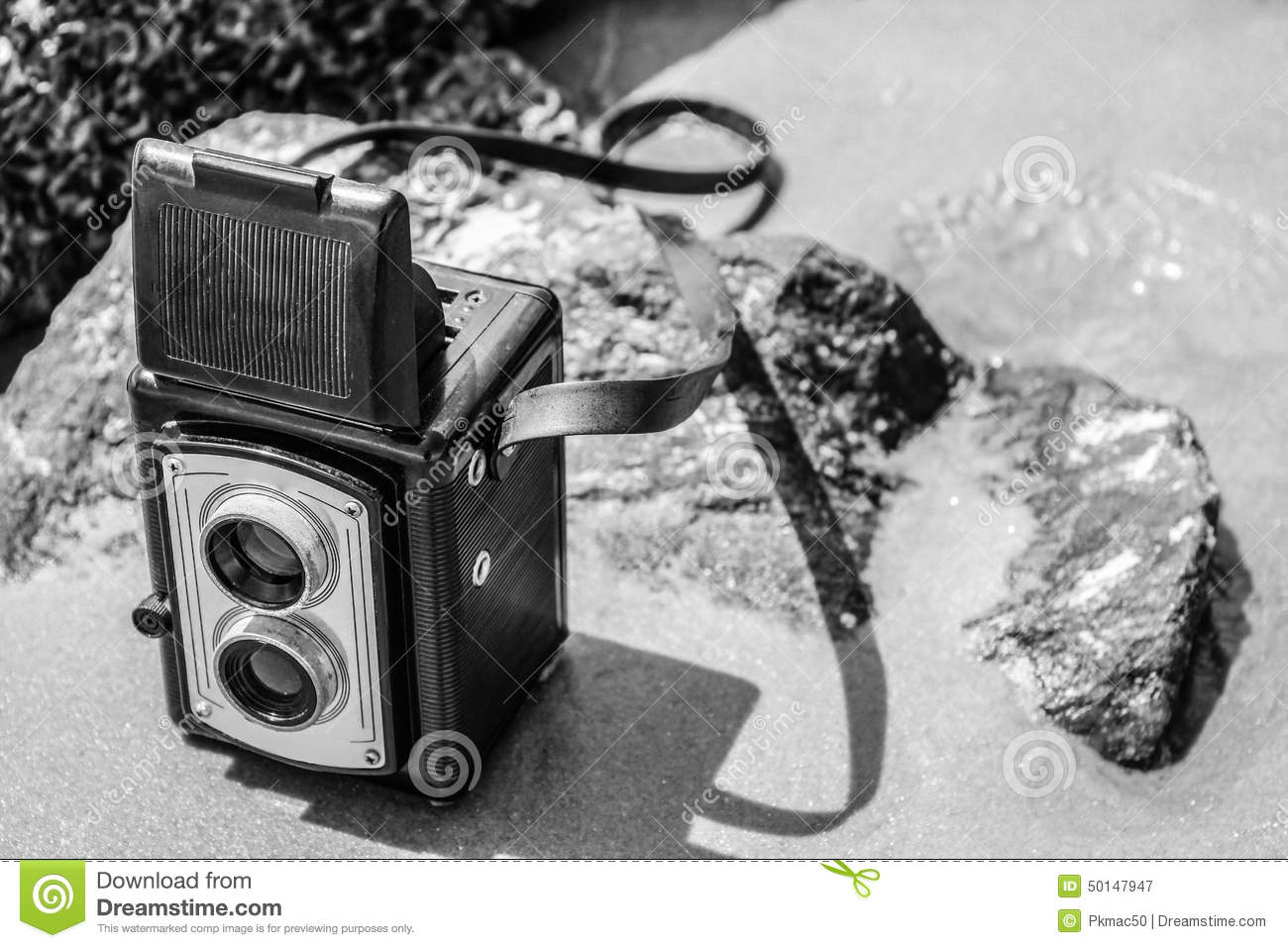 vintage camera on beach in black and white stock photo image 50147947. Black Bedroom Furniture Sets. Home Design Ideas