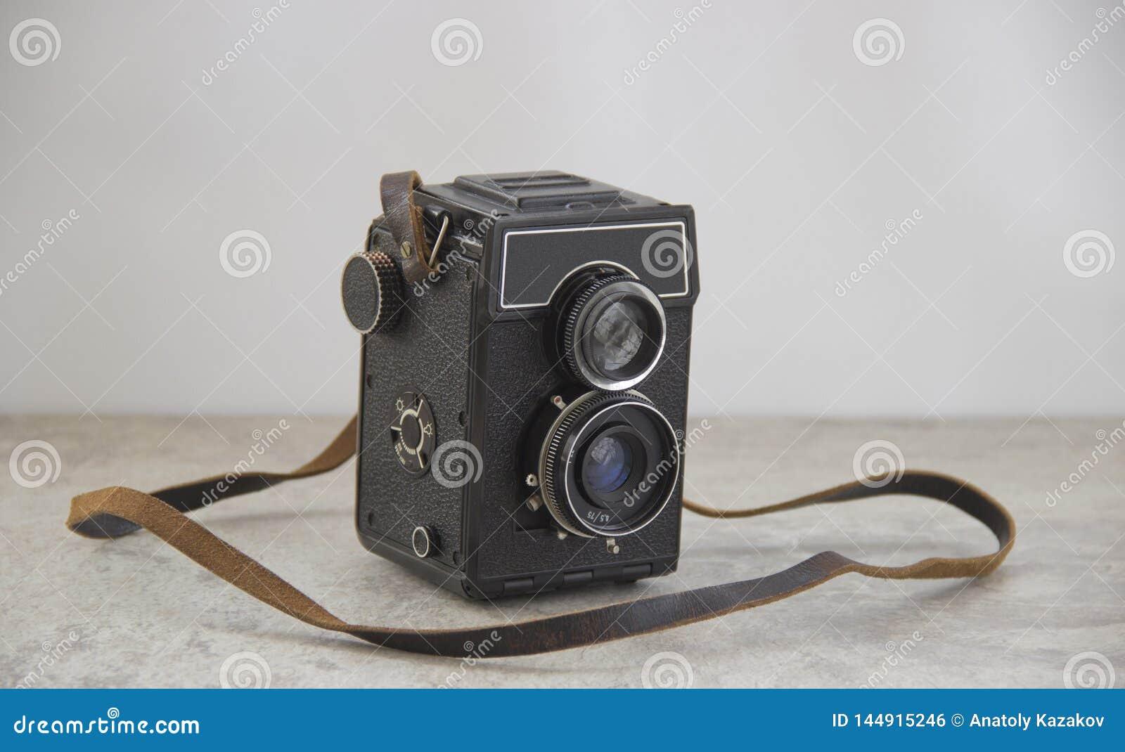 Vintage camera with strap