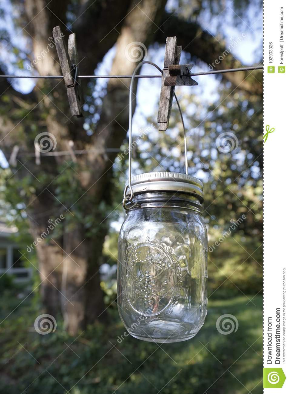 Vintage Canning Jar Outdoors On Clothesline Stock Photo - Image of ...