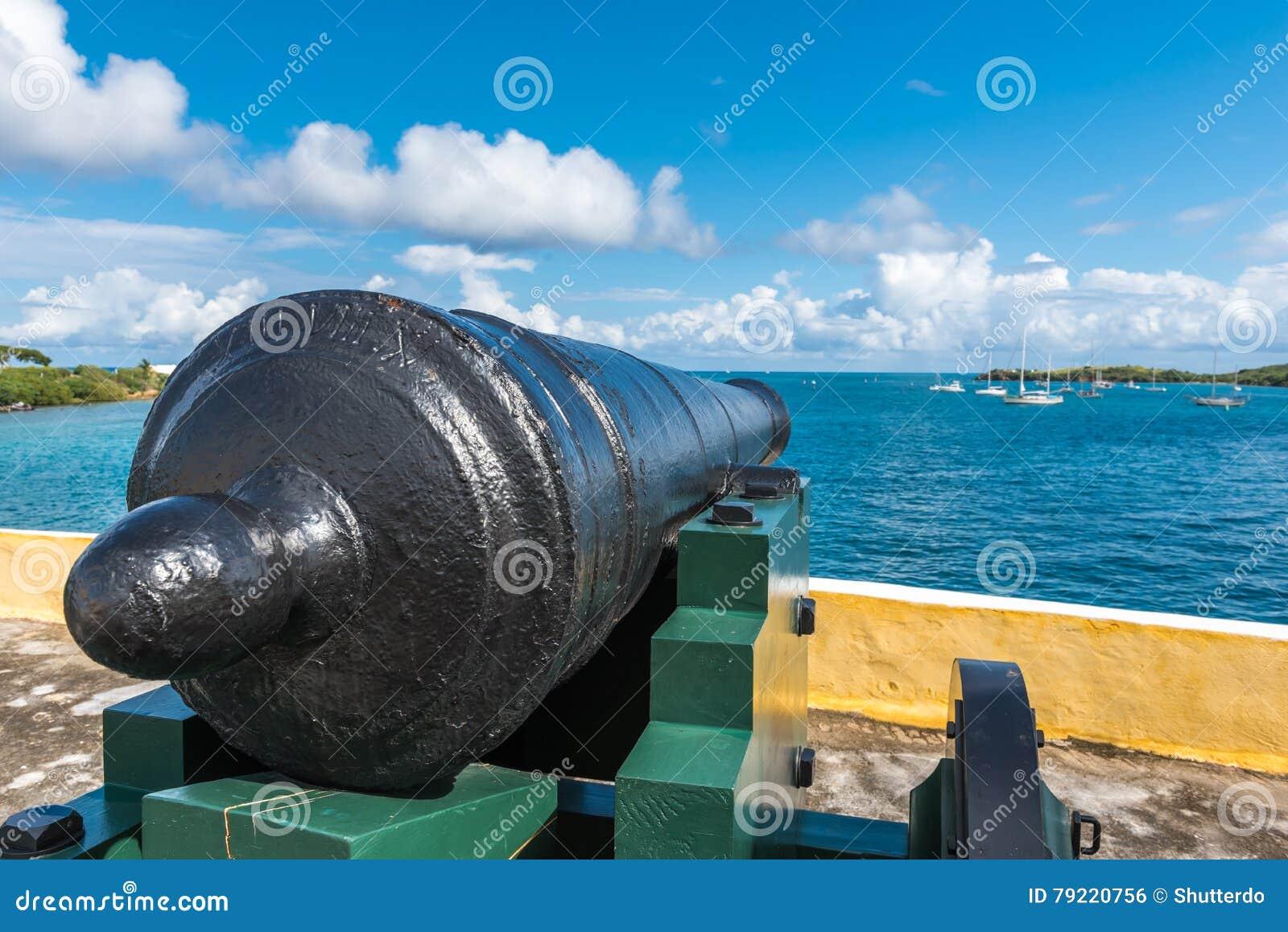 Vintage cannon facing the Caribbean ocean defending the bay. Vi