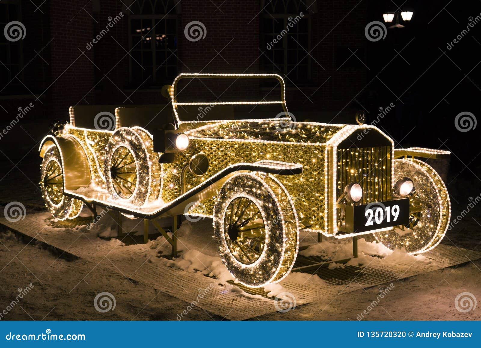 Vintage car of glowing Christmas lights