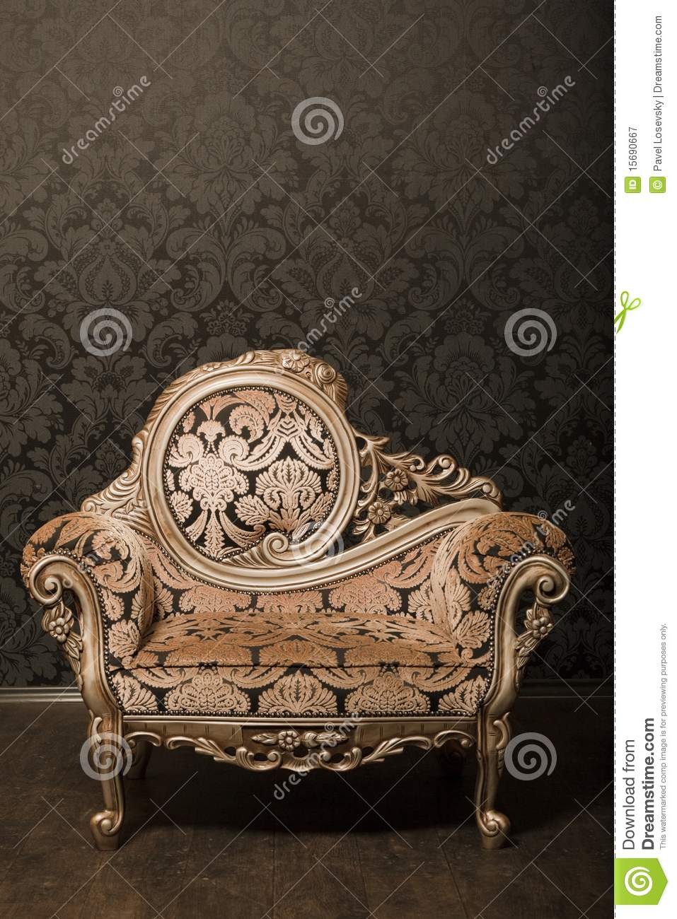 Vintage Chair With Gold Accents Beside The Wall Royalty