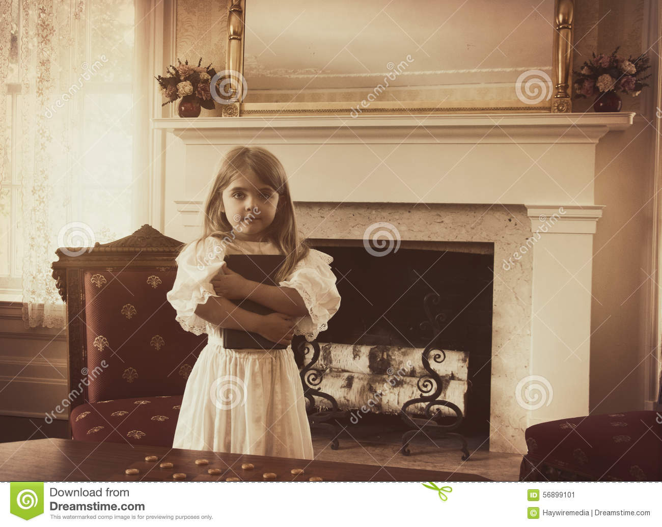 Vintage Child Holding School Book in Home