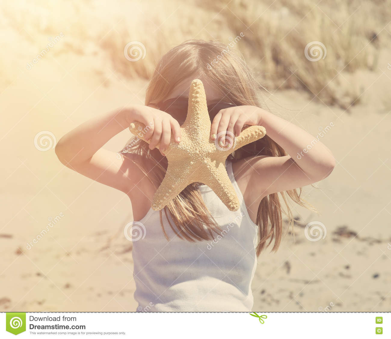 Vintage Child at Sunny Beach with StarFish