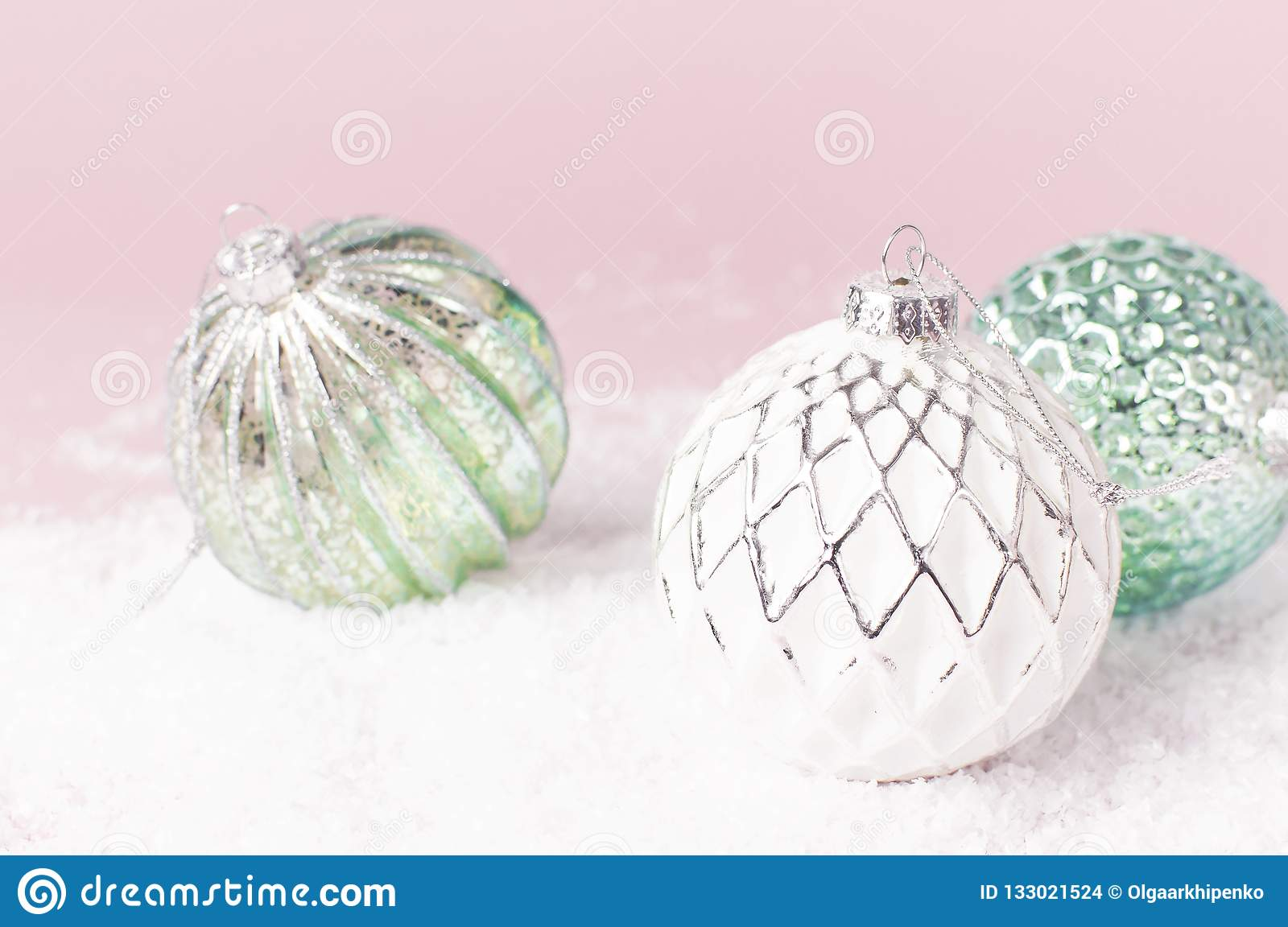 Vintage Christmas New Year balls in the snow on pink background Flat Lay copy space. Holiday Baubles, beautiful Decoration Festive