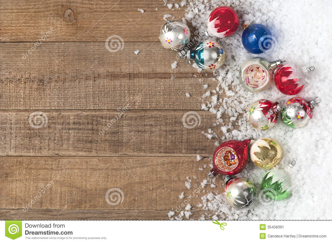 Vintage christmas ornaments in a snowdrift on wood