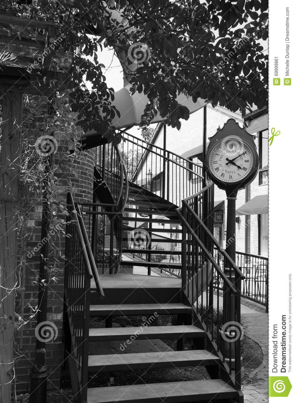 Vintage Clock and Spiral Stairs in Black and White