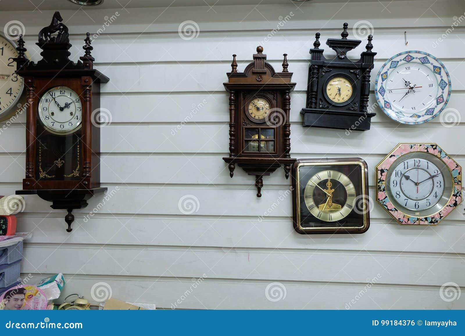 Vintage Clocks, Different Styles Old Clocks on Vintage Wall Background Background