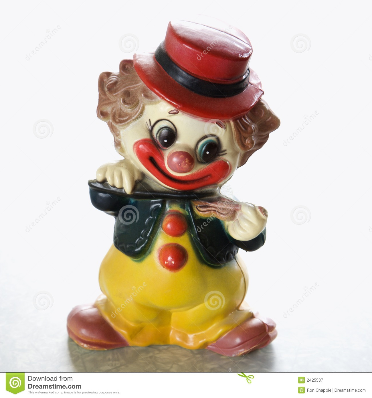 ... life of vintage colorful smiling clown figurine playing the violin