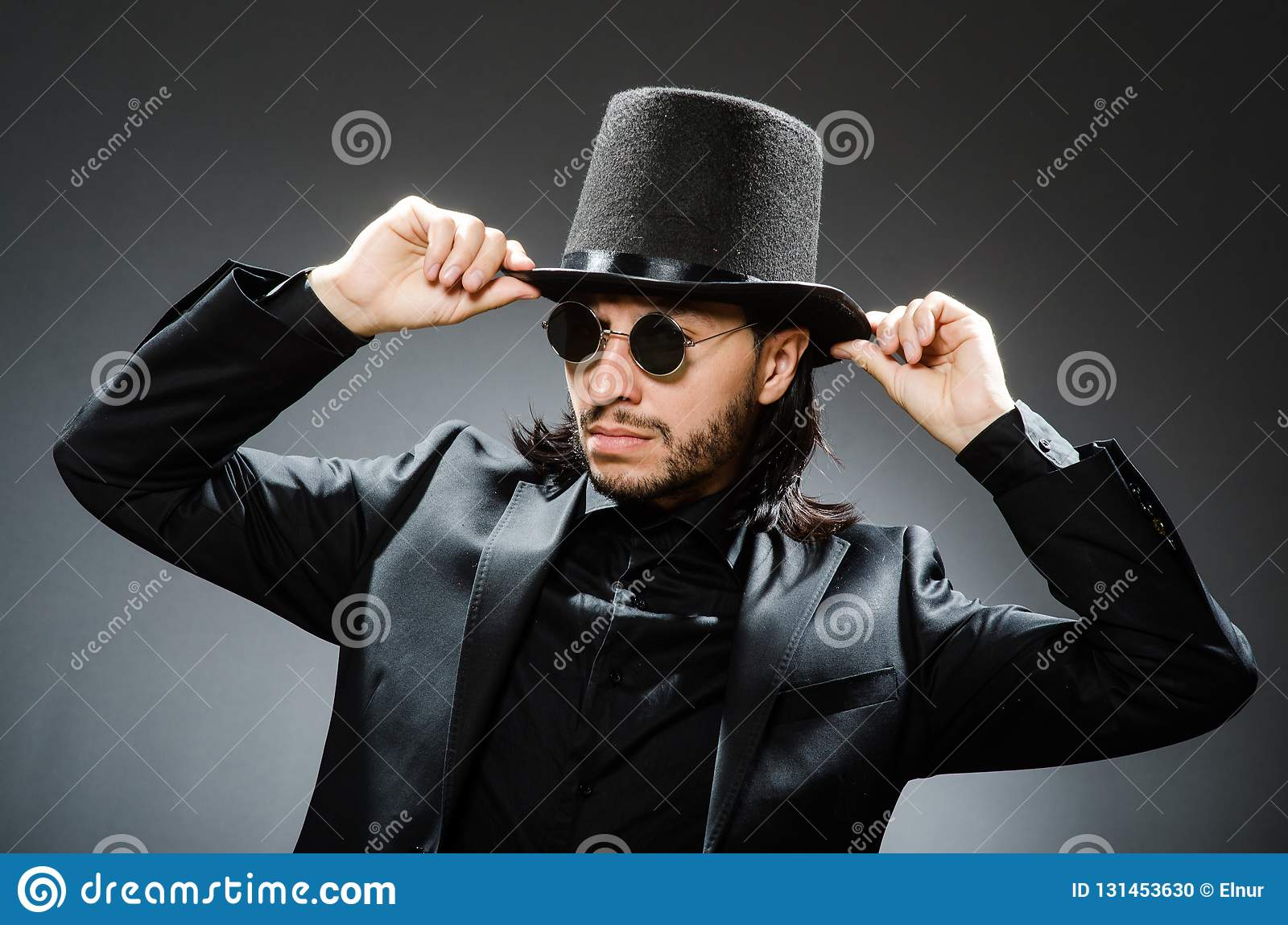 46eb246382e The Vintage Concept With Man Wearing Black Top Hat Stock Photo ...