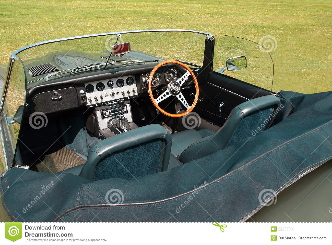 Closeup of a vintage convertible sports car interior parked in a lawn