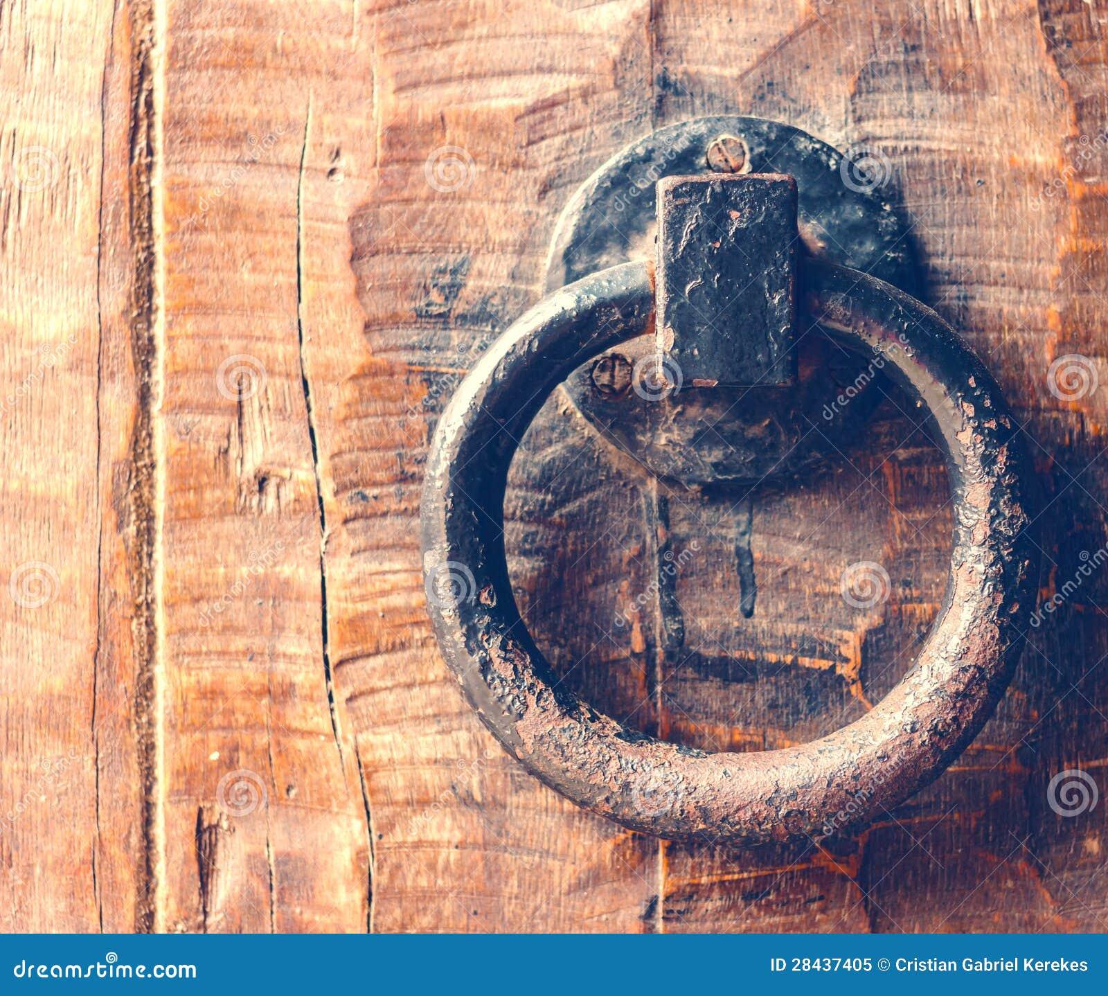 Vintage Door Knocker On Wooden Door
