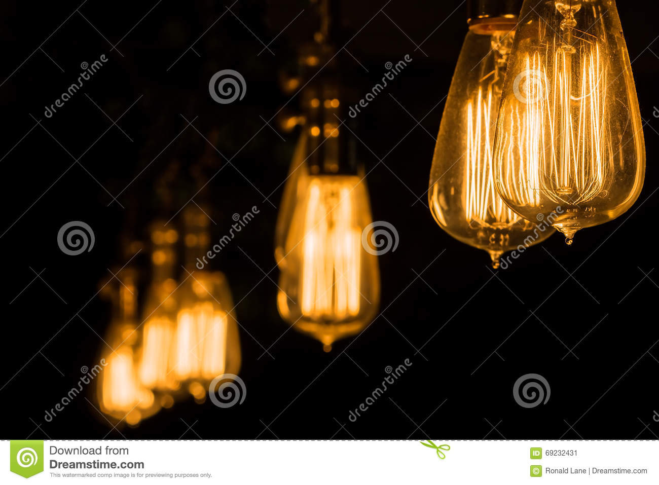 Vintage Edison Light Bulbs Hanging Against A Black Background Stock Image Image Of Closeup