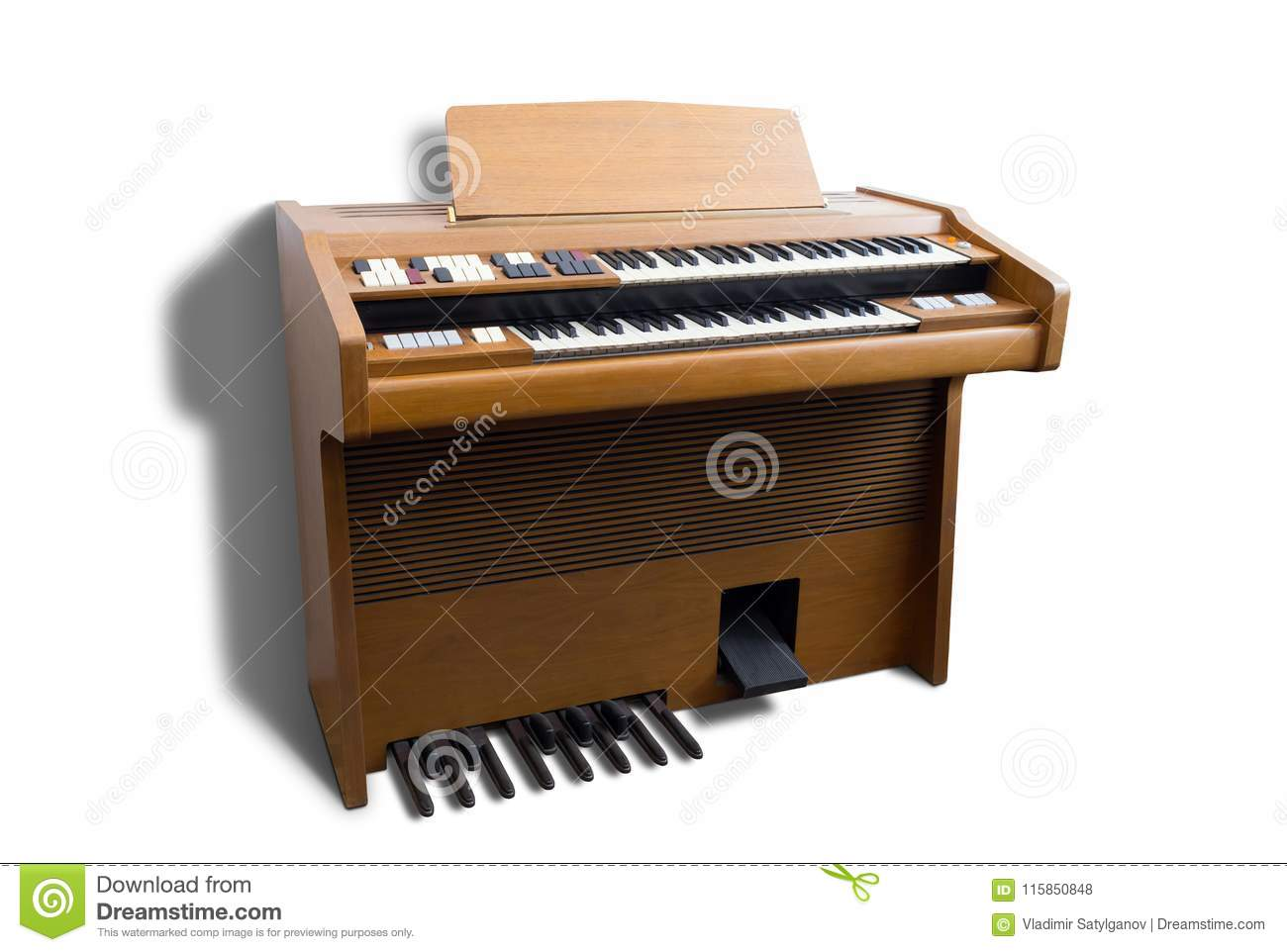 Old-fashioned double-keyboard electric organ isolated on white background