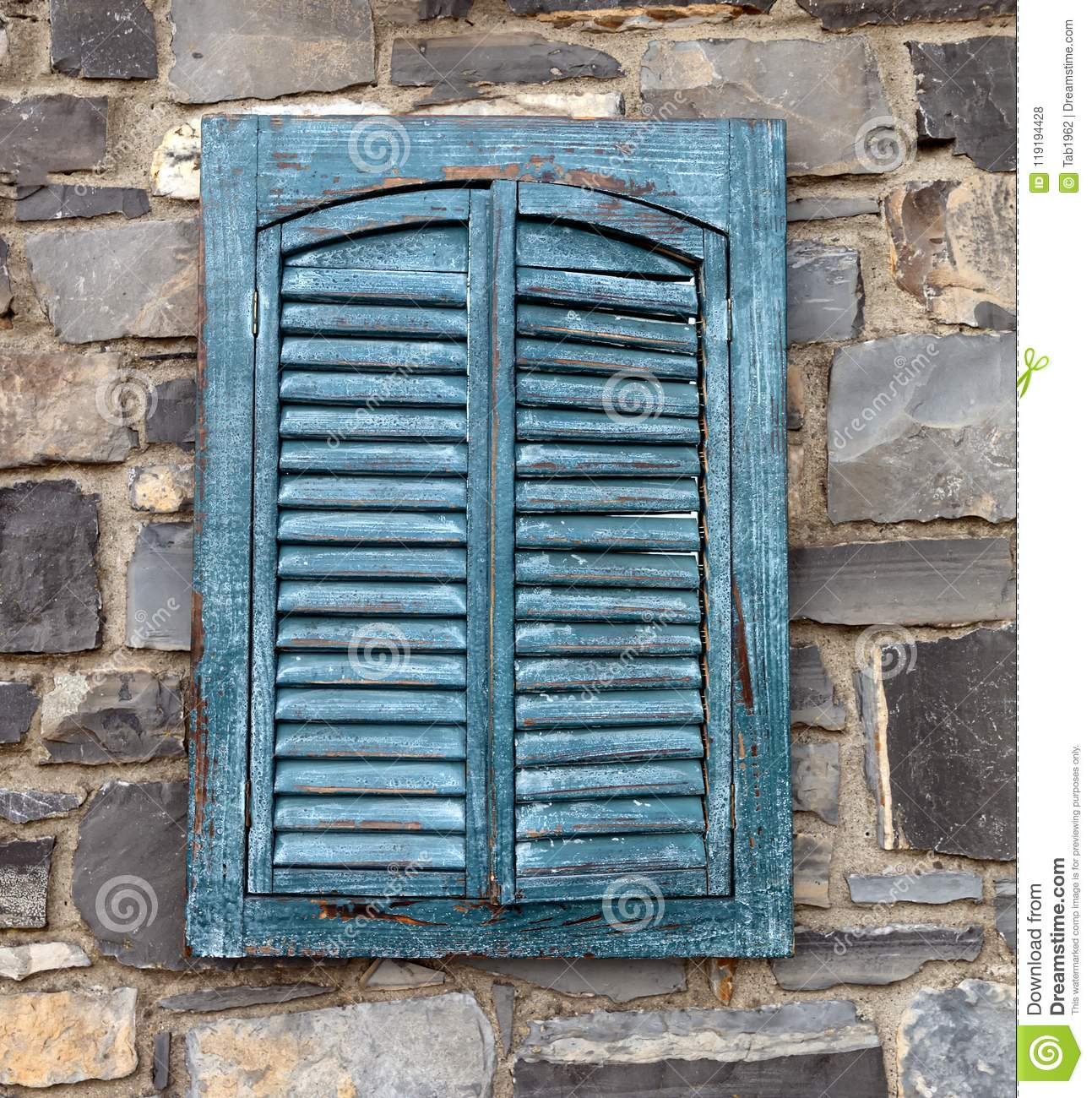 Vintage Exterior Shutters On Aged Stone Wall Structure Stock