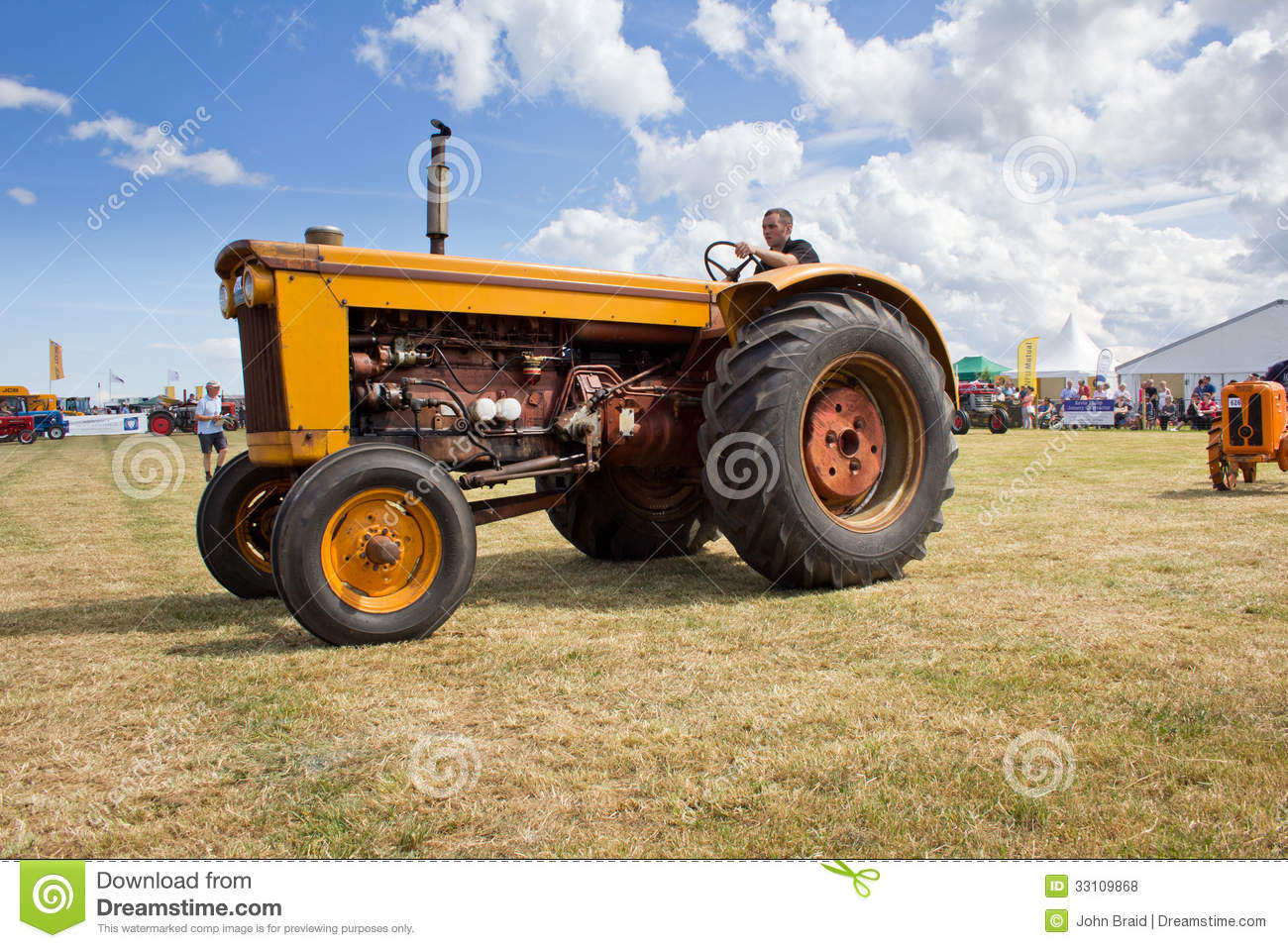 Farmer On Tractor : Vintage farm tractor editorial stock photo image of field