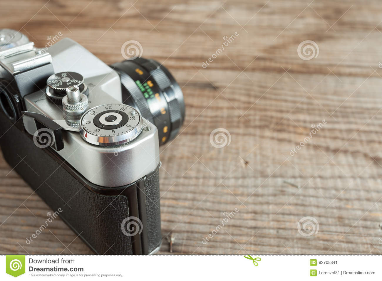 vintage film camera lying over a dated wooden background stock