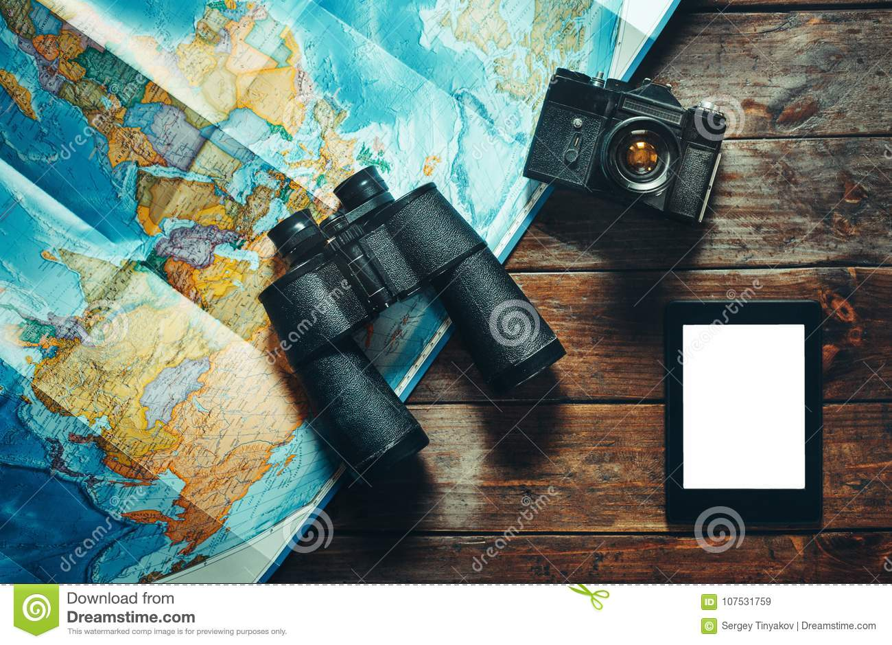 Vintage Film Camera, Map, Tablet And Binoculars On Wooden Table, Top View. Adventure Travel Scout Journey Concept