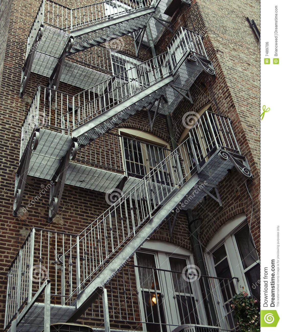 Old Brick Apartment Building: Vintage Fire Escape Royalty Free Stock Image