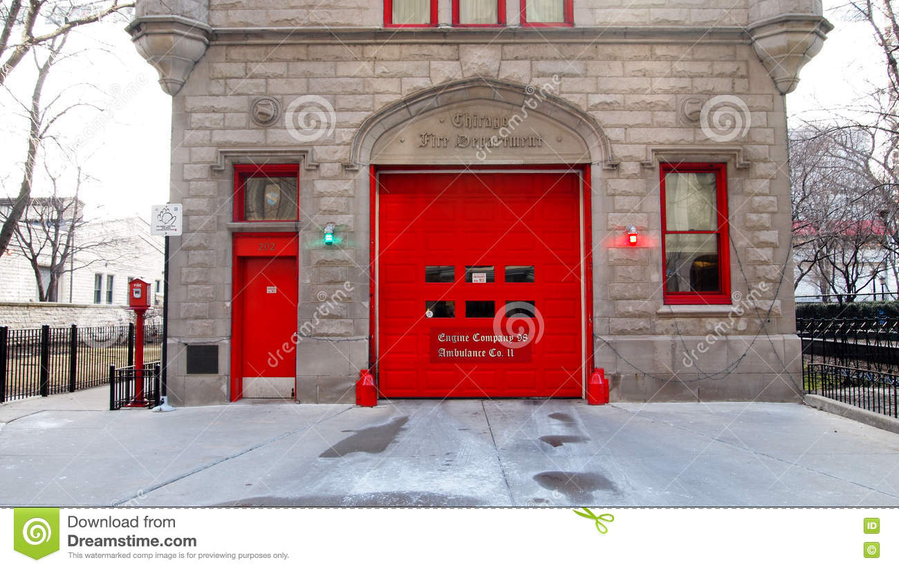 Bright red doors on an Old Firehouse with a single garage in the old ...