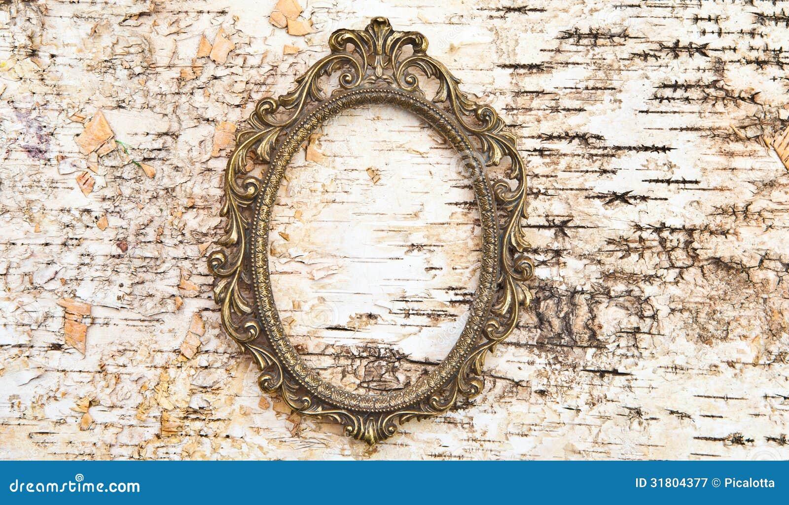 Vintage frame on rustic wooden background