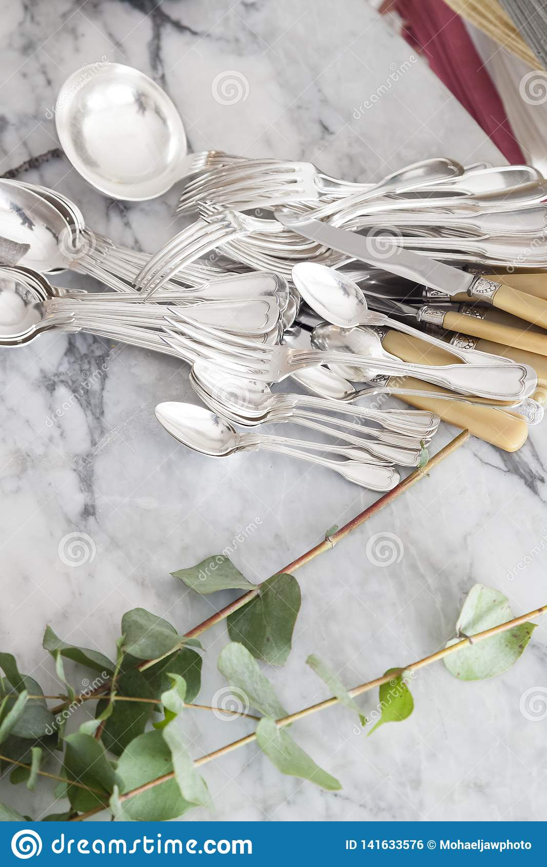 Vintage french cutlery concept with leabes and marble