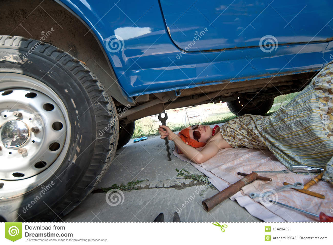 Vintage Girl With Tools Under Car Stock Photo - Image of adult, auto ...