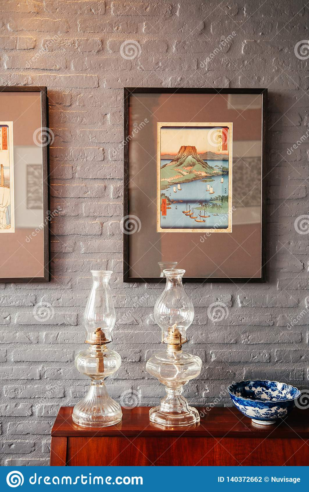 Vintage Glass Kerosene Lamp And Antique Ceramic Pedestal Tray With Brick Wall Background Editorial Photography Image Of Texture Brick 140372662