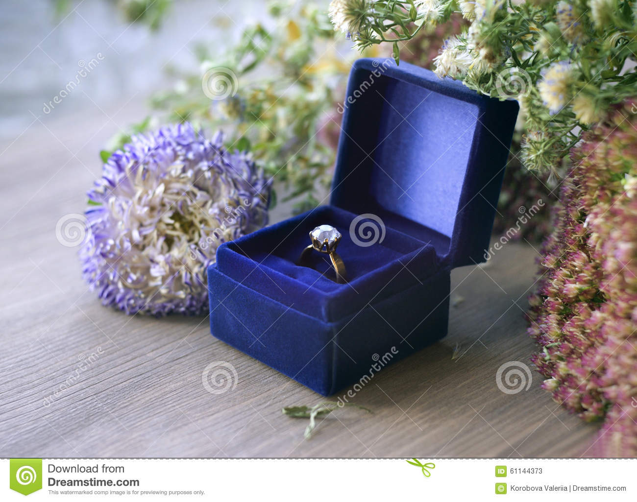 Vintage gold diamond engagement ring in blue velvet box