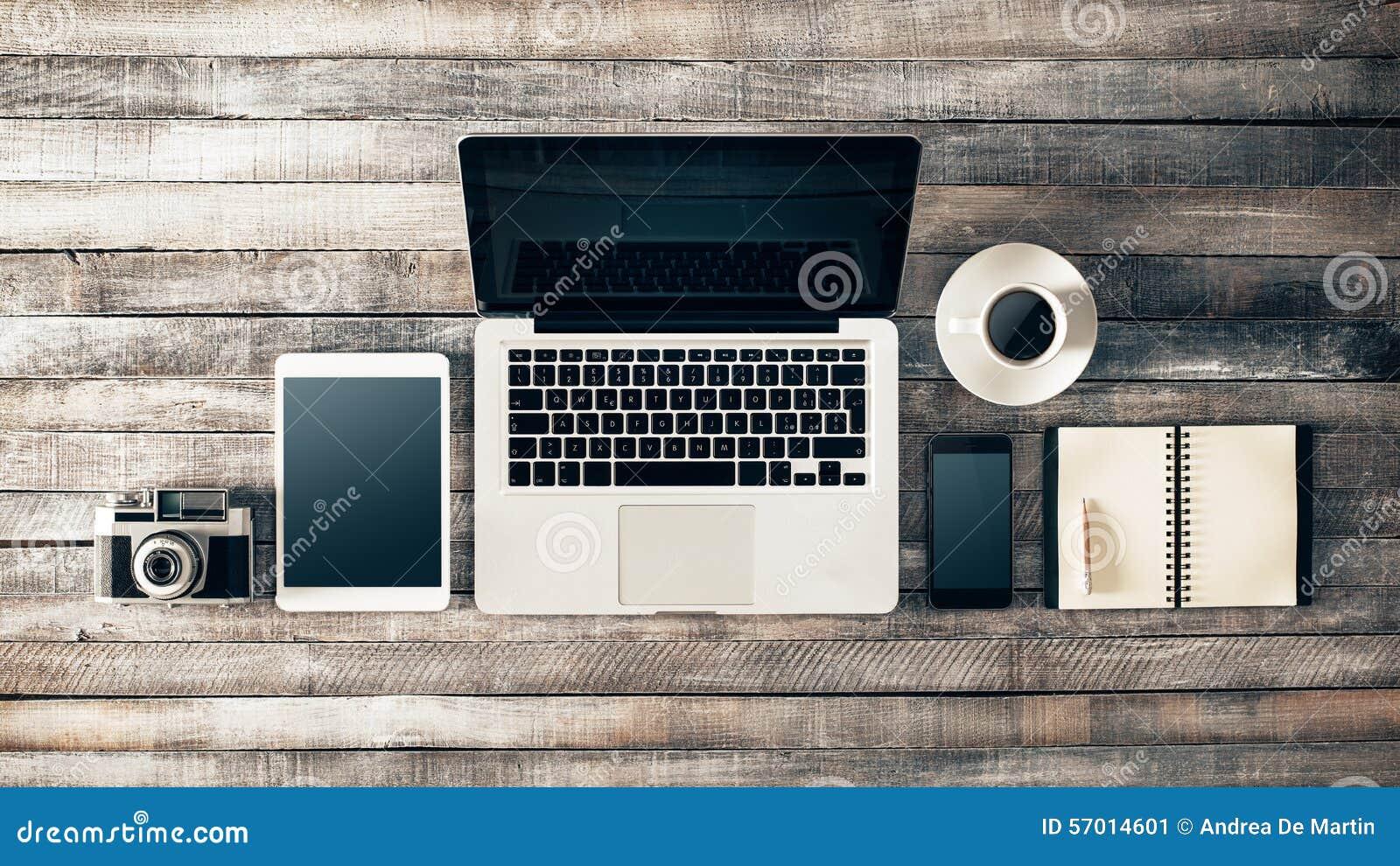 Vintage grunge desktop with laptop