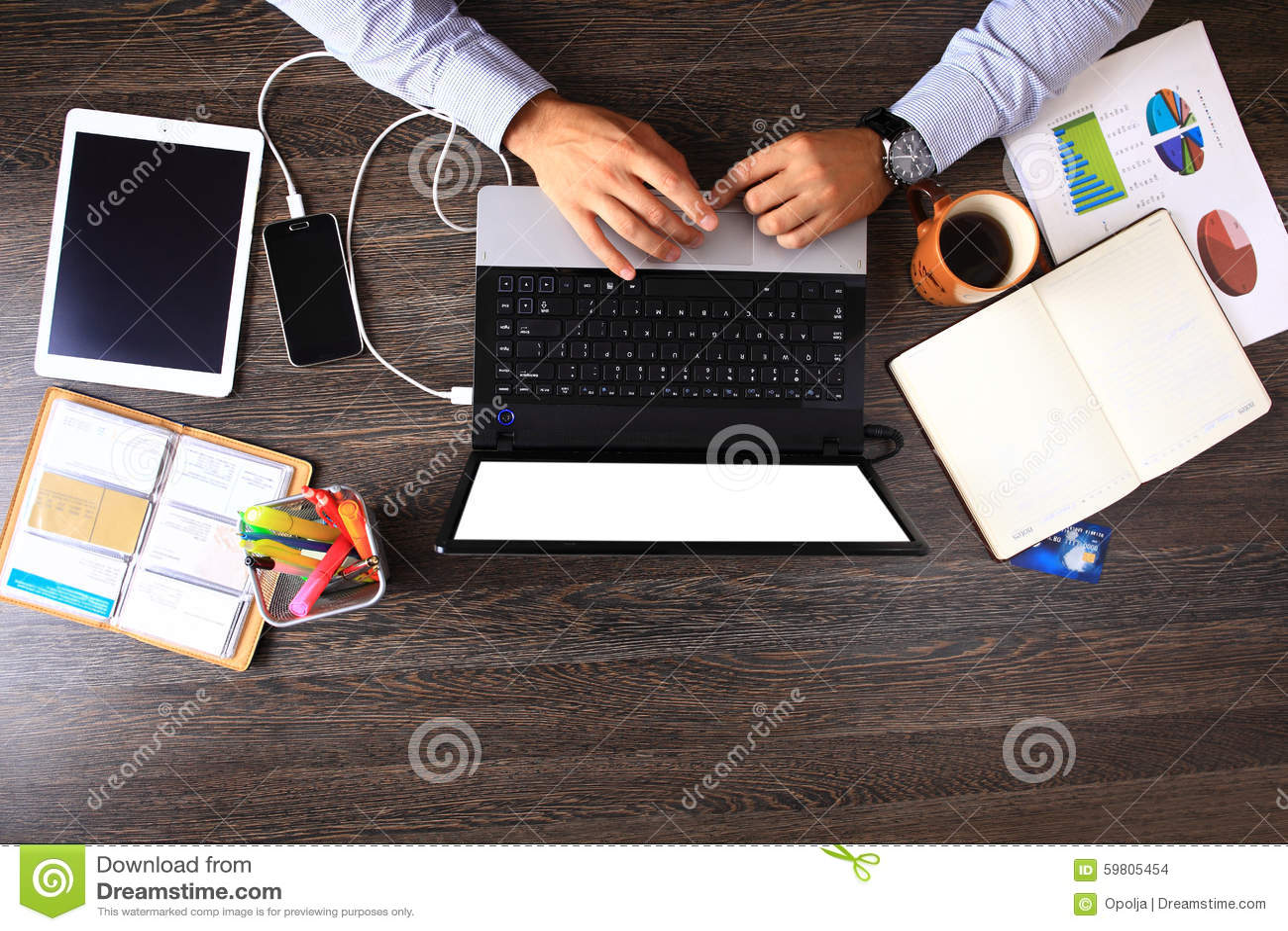 Vintage hipster wooden desktop top view, male hands using laptop